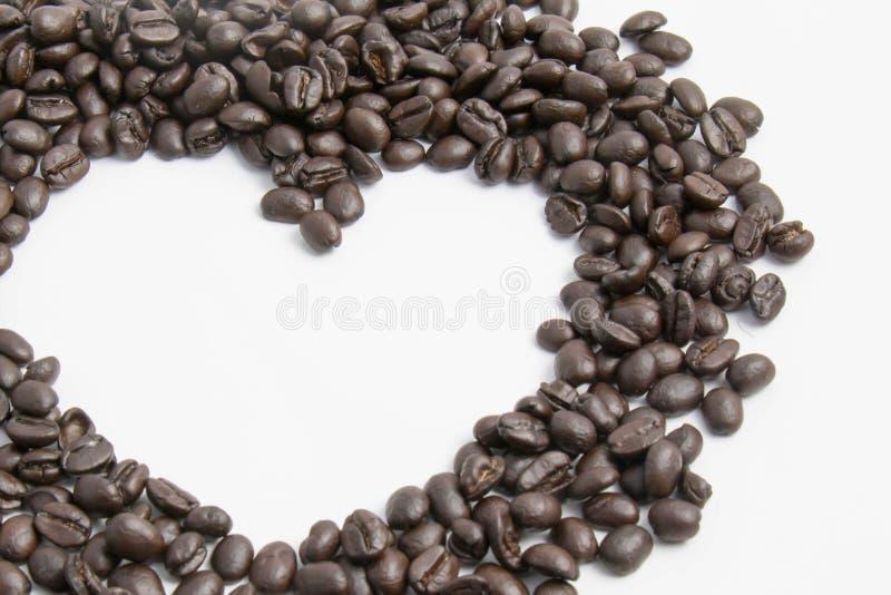Coffee bean in heart shape stock photo