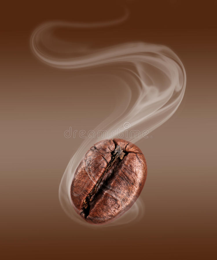 Coffee bean with hot steam close-up.  stock photos