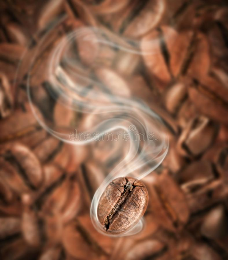 Coffee bean with hot steam close-up. On a background of lots of coffee beans royalty free stock image