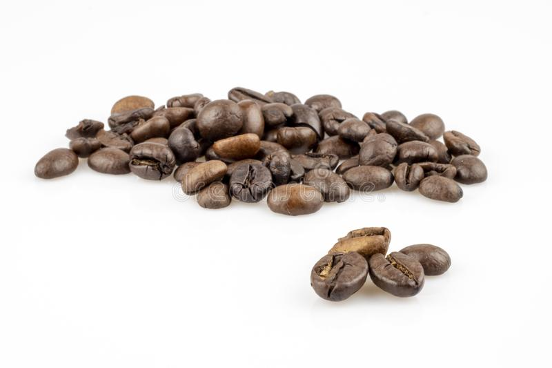 Coffee Bean - isolated on white background. Four coffee beans in the foreground royalty free stock photography