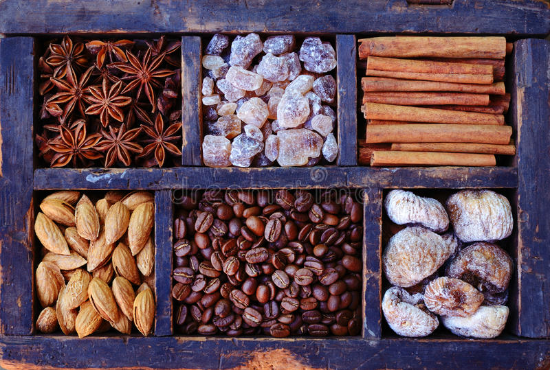 Coffee bean, nuts and spices in rusted wooden display royalty free stock photo