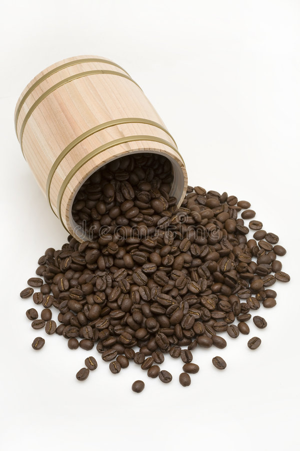 Coffee bean out of oak drum royalty free stock photography