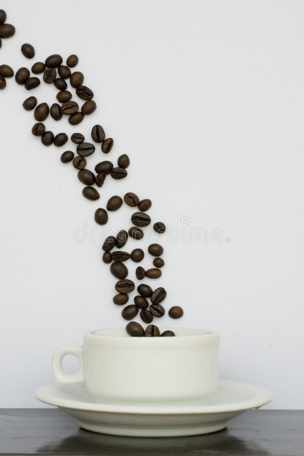 Coffee bean and white cup stock image