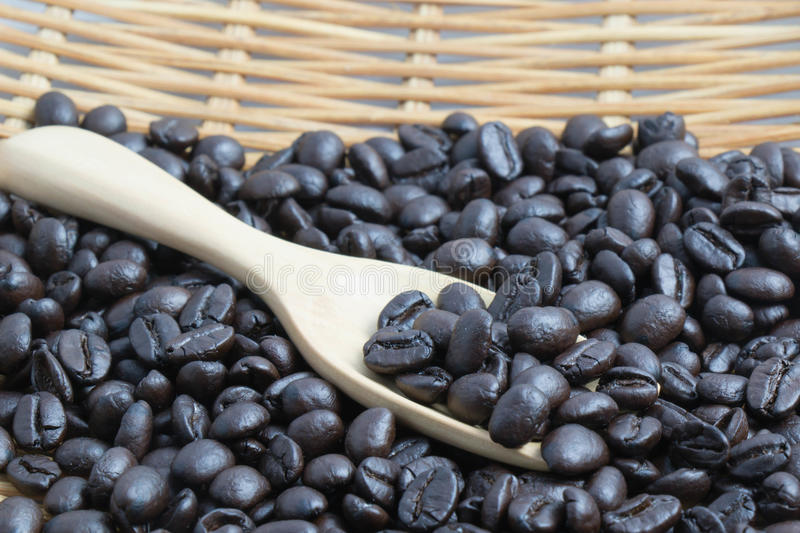 Coffee bean with wooden spoon royalty free stock photos
