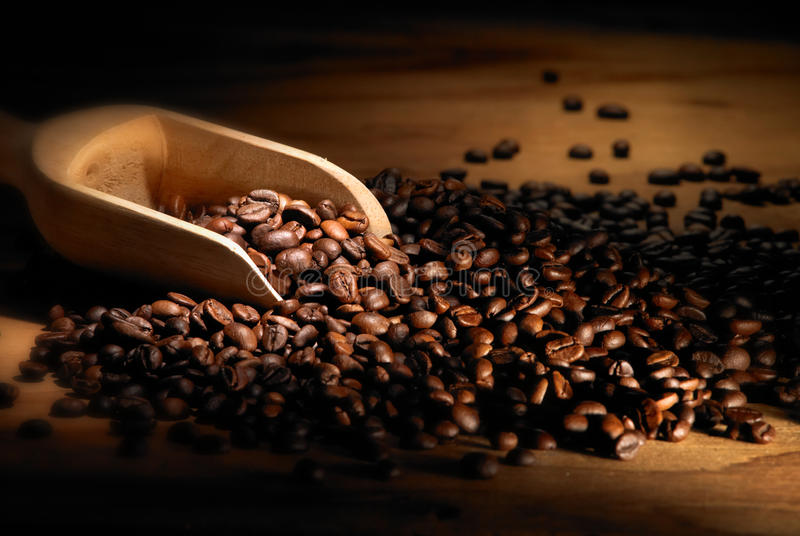 Coffee beans. With wood table background stock images