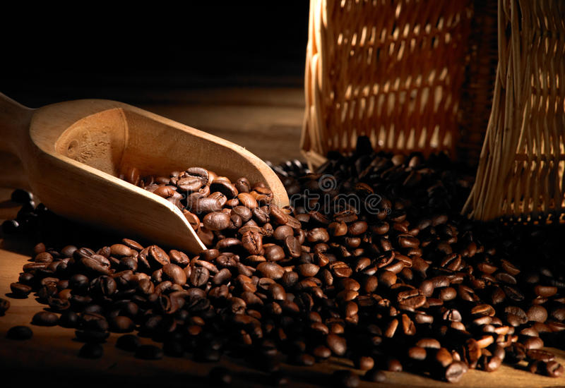 Coffee beans. On wood table with basket royalty free stock photos