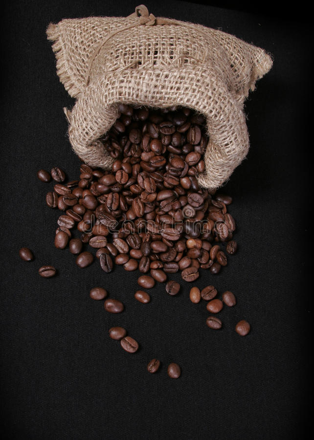 Coffee beans. Scattered on a black background stock images