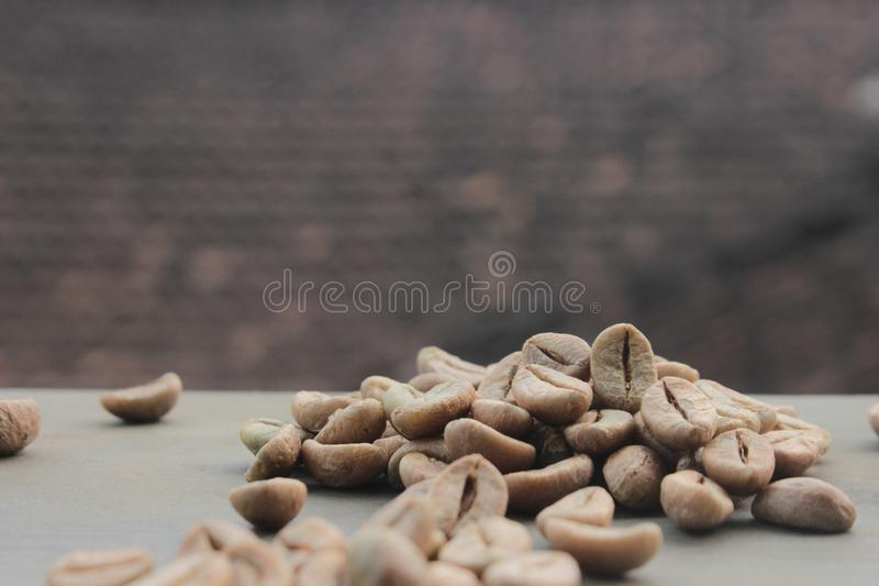 Coffee beans background with focus on coffee royalty free stock photo