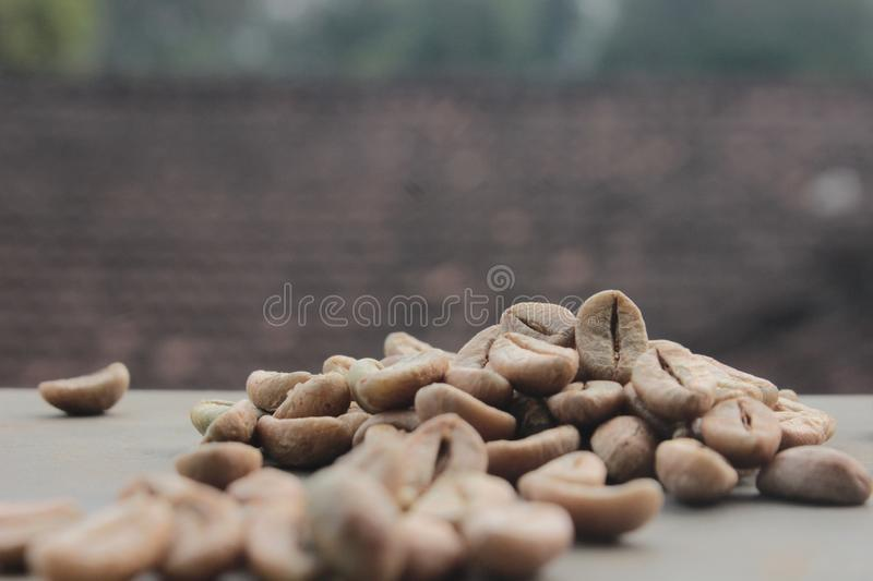 Coffee beans background with focus on coffee stock photography