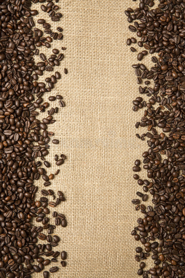 Coffee beans on the background of jute fabrics stock photography