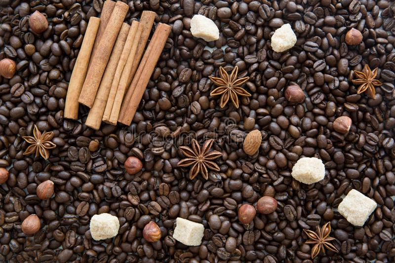 Coffee beans background with spices: anise and cinnamon sticks. stock image