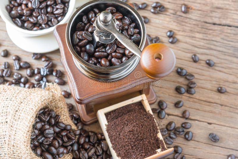 Coffee beans in the bag and grinder. royalty free stock photos