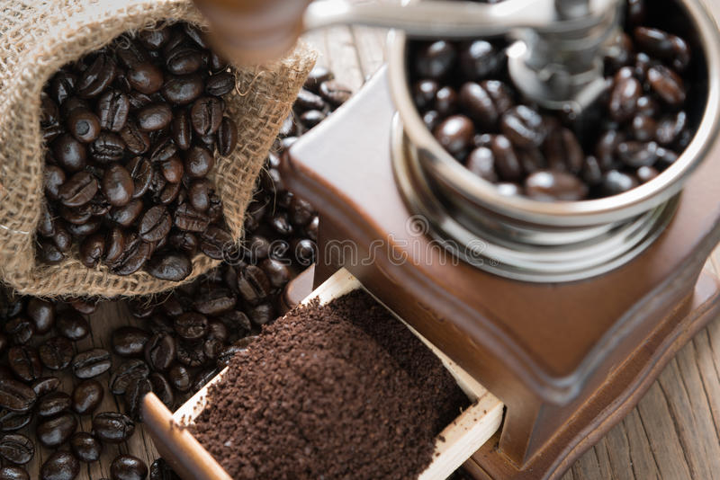 Coffee beans in the bag and grinder. stock images