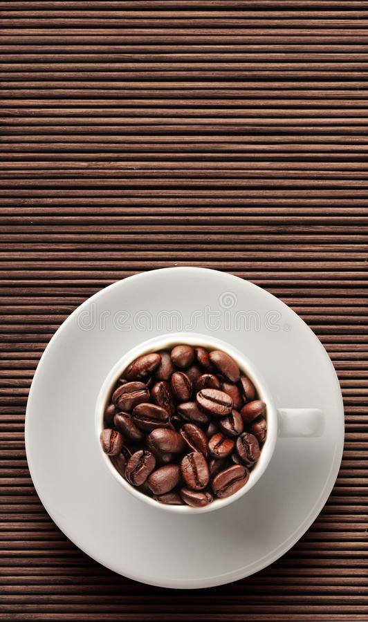 Coffee beans on bamboo floor stock photo