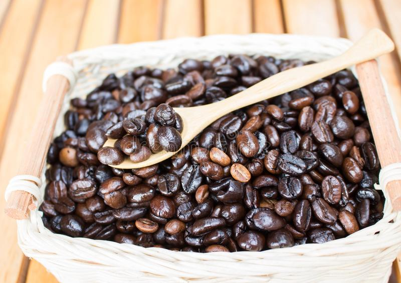 Coffee beans in basket stock photography