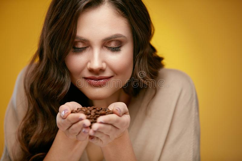 Coffee Beans. Beautiful Woman Smelling Coffee Beans royalty free stock photography