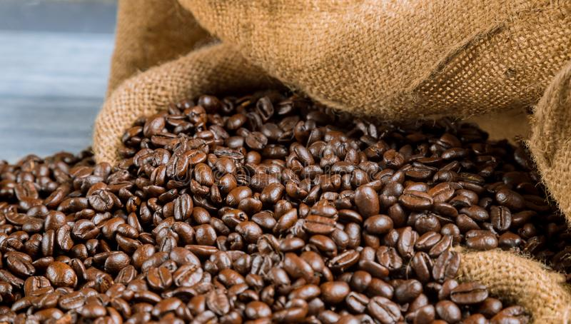 Coffee beans in a big sackcloth bag royalty free stock images