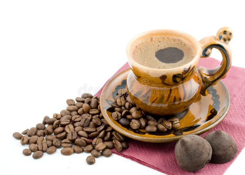 Coffee beans and black coffee in a cup royalty free stock images
