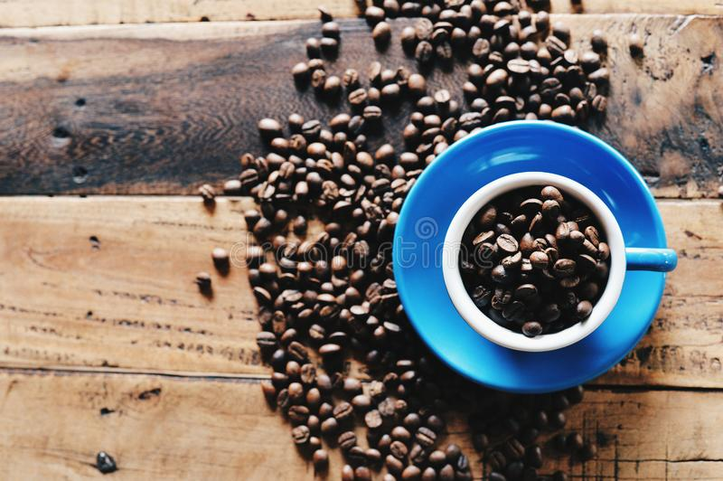 Coffee beans in blue cup royalty free stock image