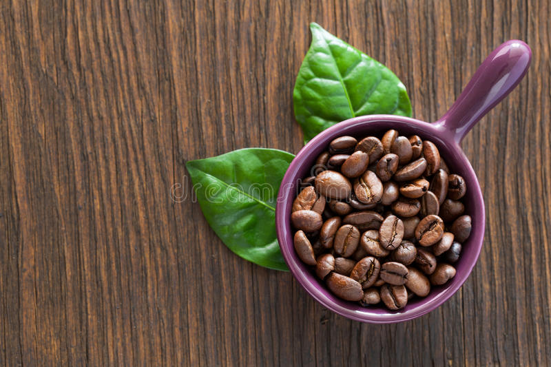 Coffee beans in a bowl stock images