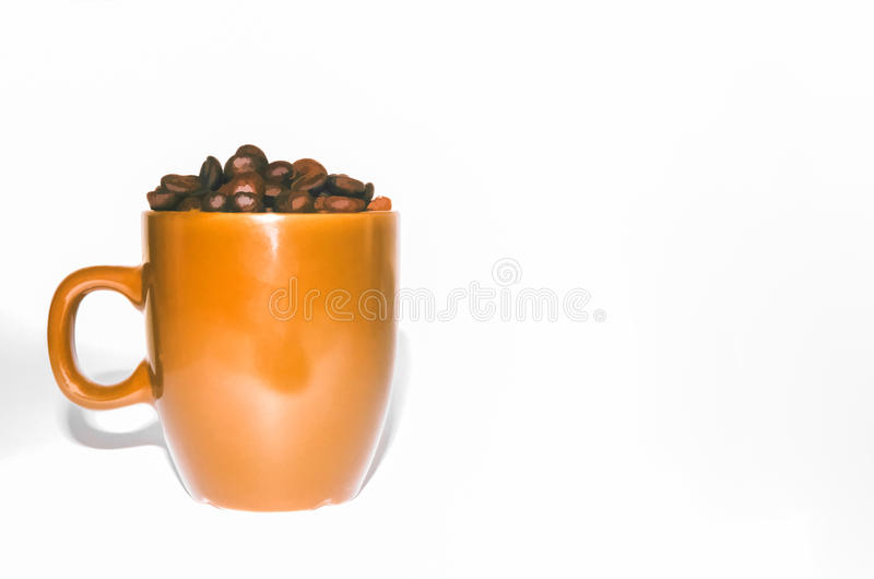 Coffee beans in a brown cup, white background stock photo
