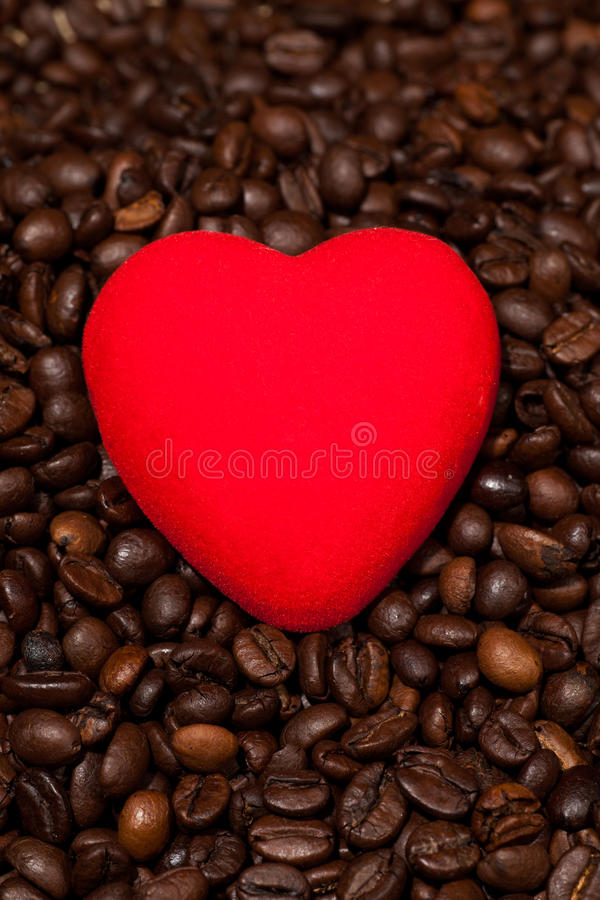 Coffee beans in burlap sack and red heart stock photo
