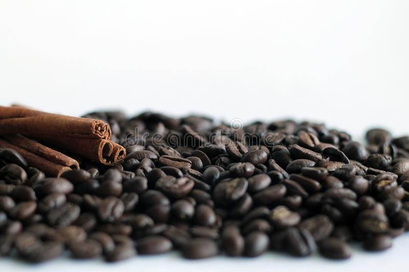 Coffee beans and cinnamon sticks isolated on white background. stock photo