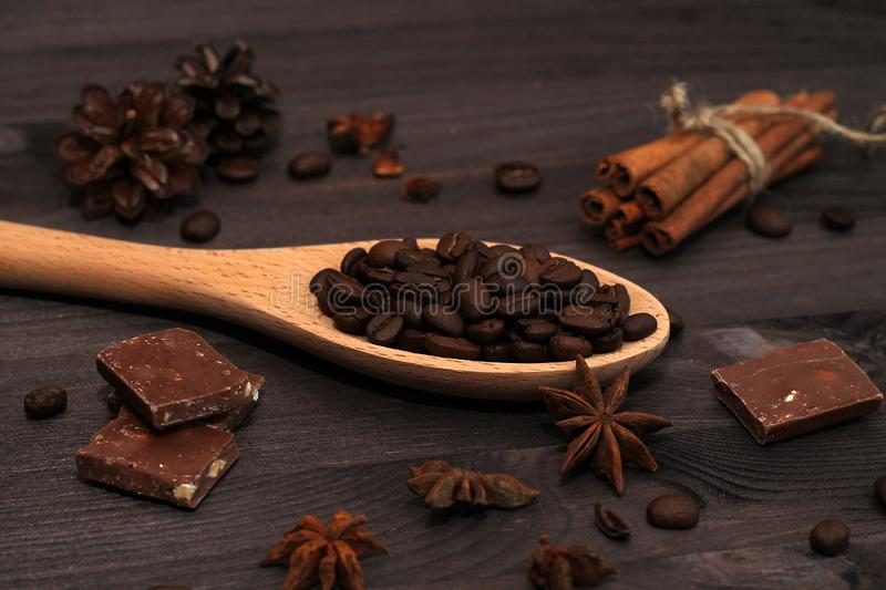 Coffee beans and cinnamon sticks isolated on wooden background royalty free stock images