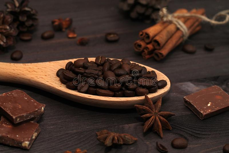 Coffee beans and cinnamon sticks isolated on wooden background stock image