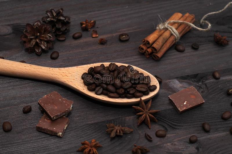 Coffee beans and cinnamon sticks isolated on wooden background stock photo