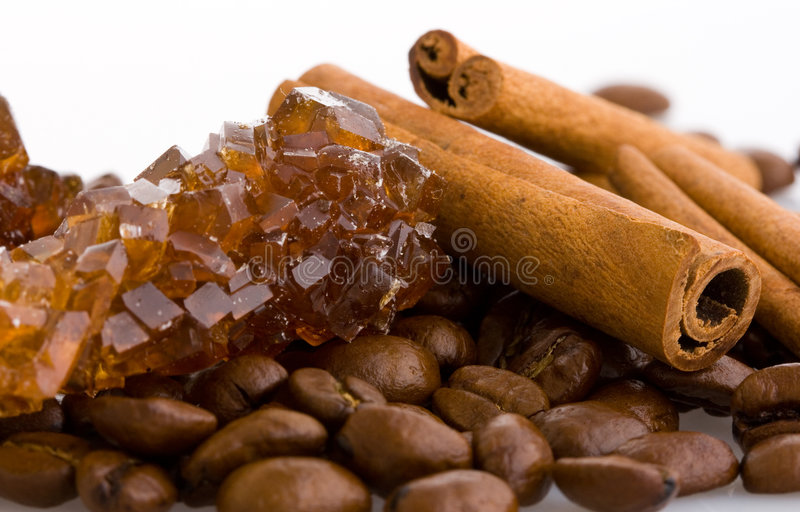 Coffee beans, cinnamon and sugar crystals royalty free stock images