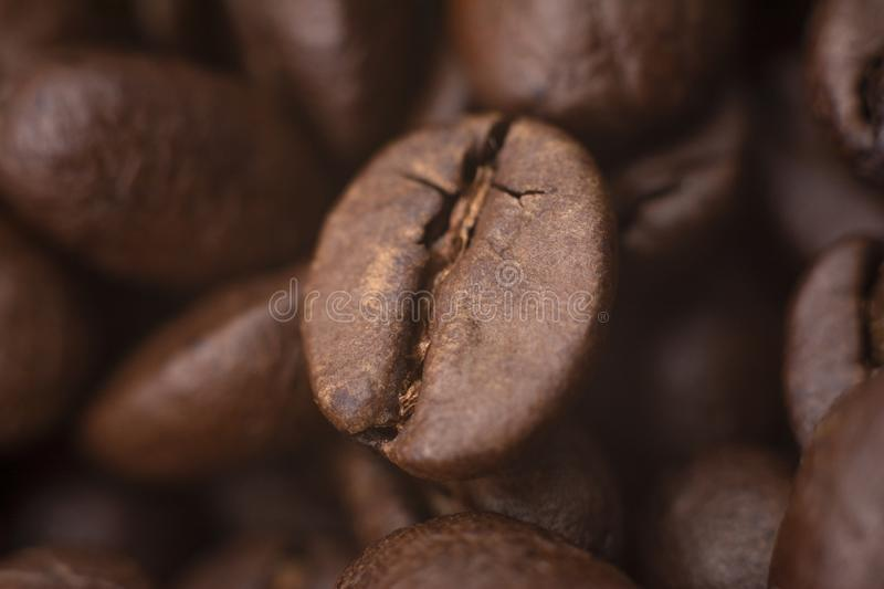 Closeup of coffee beans with focus on one. Coffee beans background stock photos