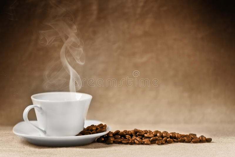 Coffee beans and coffee cup royalty free stock photo