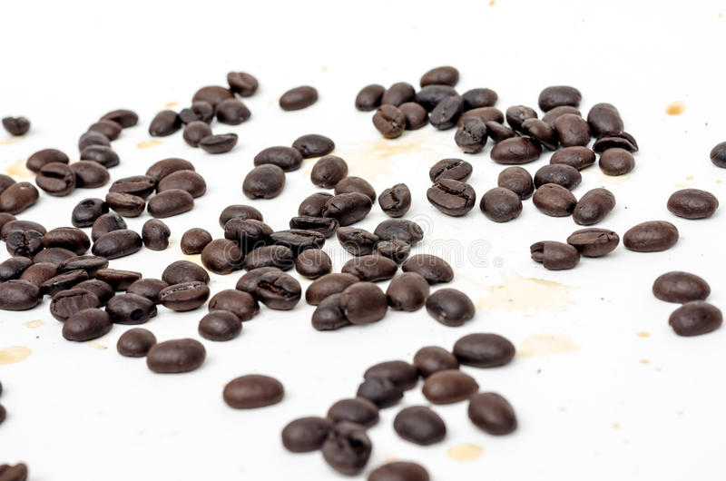 Coffee beans and coffee stain. On white background stock photo