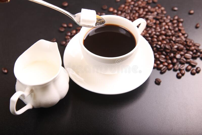 Coffee with coffee beans stock images