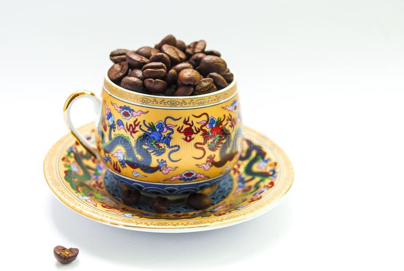 Coffee beans in a cup close-up royalty free stock photography