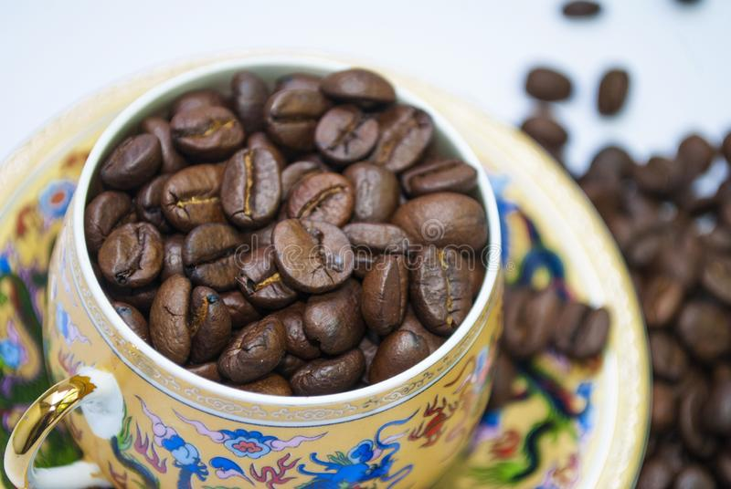 Coffee beans in a cup close-up stock photo