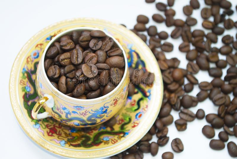 Coffee beans in a cup close-up royalty free stock image