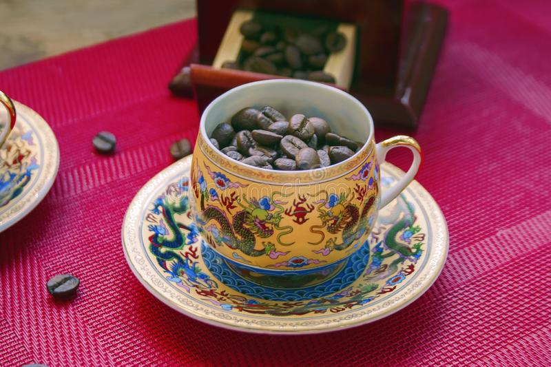 Coffee beans in a cup with a pattern stock image