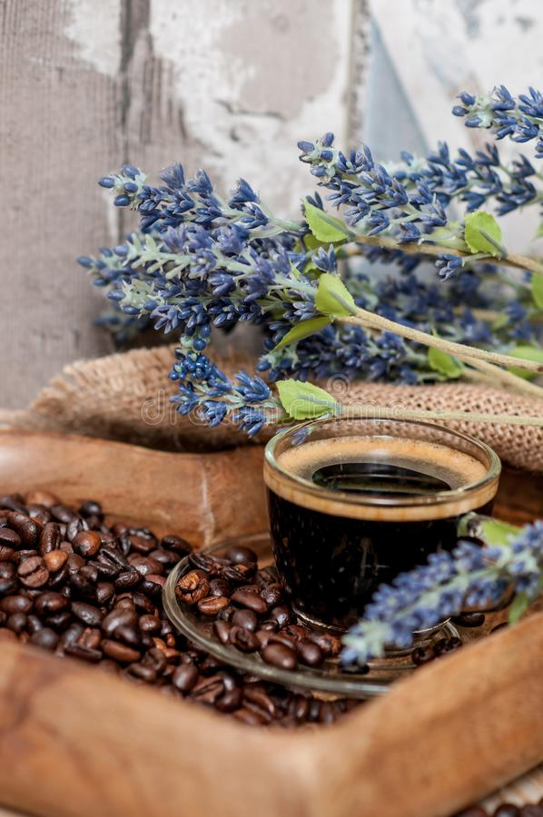 Coffee beans and a cup of espresso stock image