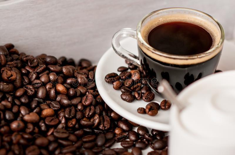 Coffee beans and a cup of espresso royalty free stock images