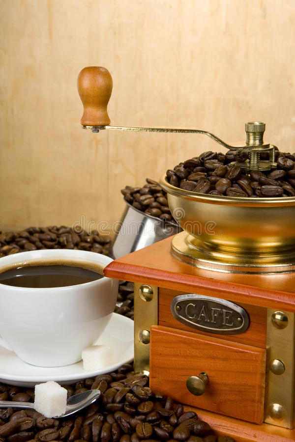 Coffee Beans, Cup And Grinder On Wood Royalty Free Stock Photography
