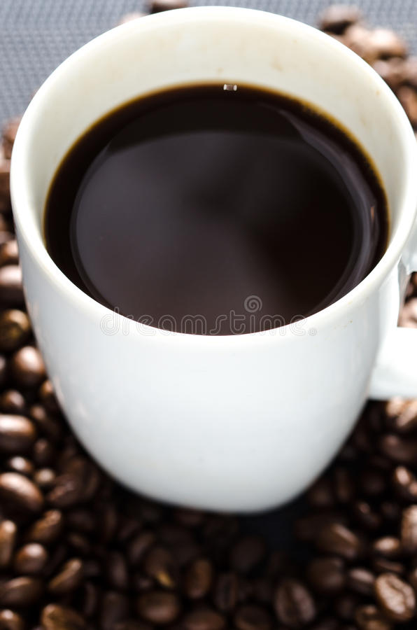 Coffee beans and cup royalty free stock photos