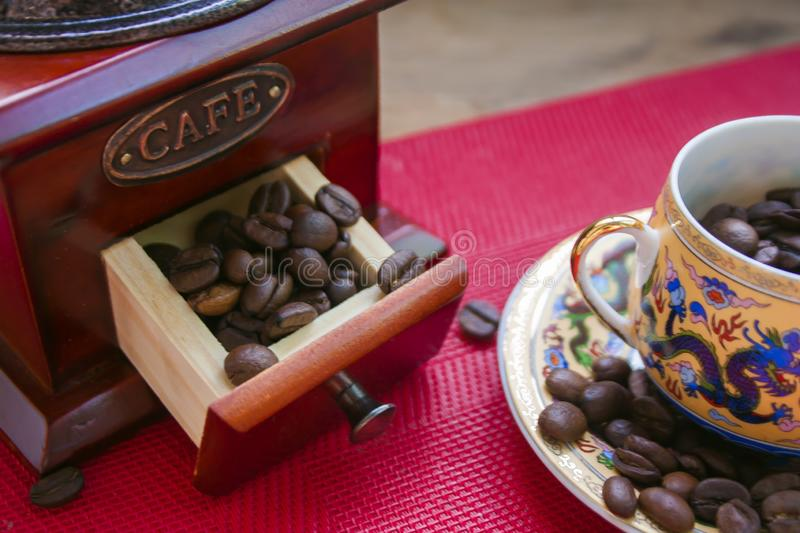 Coffee beans in a cup with a pattern stock photography