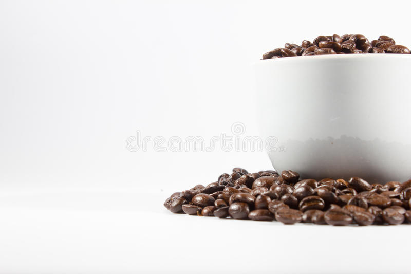 Coffee Beans and cup. On white background royalty free stock photo