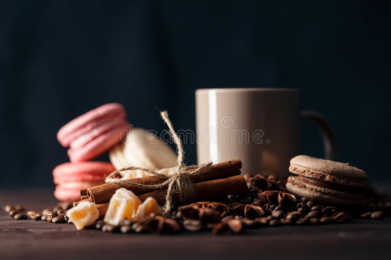 Coffee beans in cup on wooden background stock photography