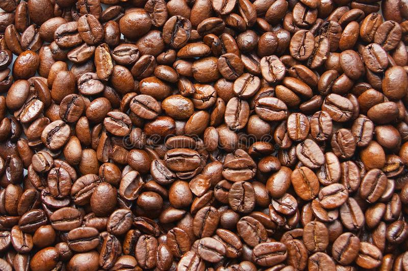 Coffee beans detail a brown coffeee. Nice healthy food and drink stock image