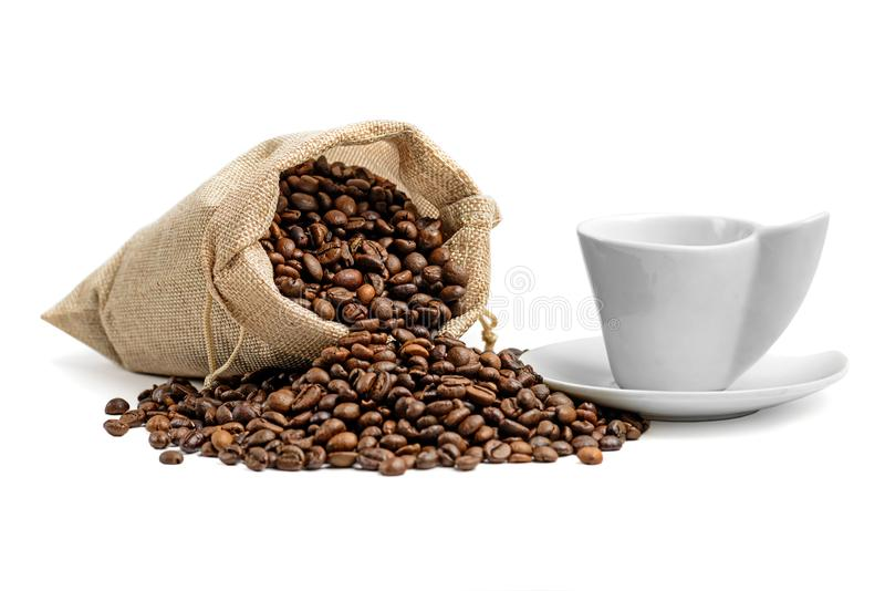 Coffee beans and espresso cup stock images