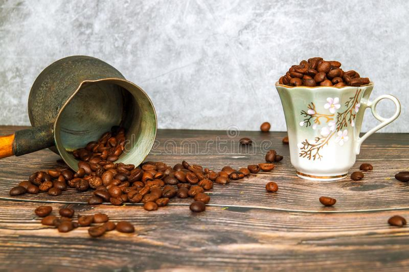 Coffee beans falling on wood table, vintage toned. How to choose a quality coffee. stock photography