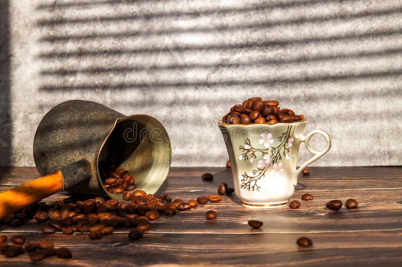 Coffee beans falling on wood table, vintage toned. How to choose a quality coffee. royalty free stock photos